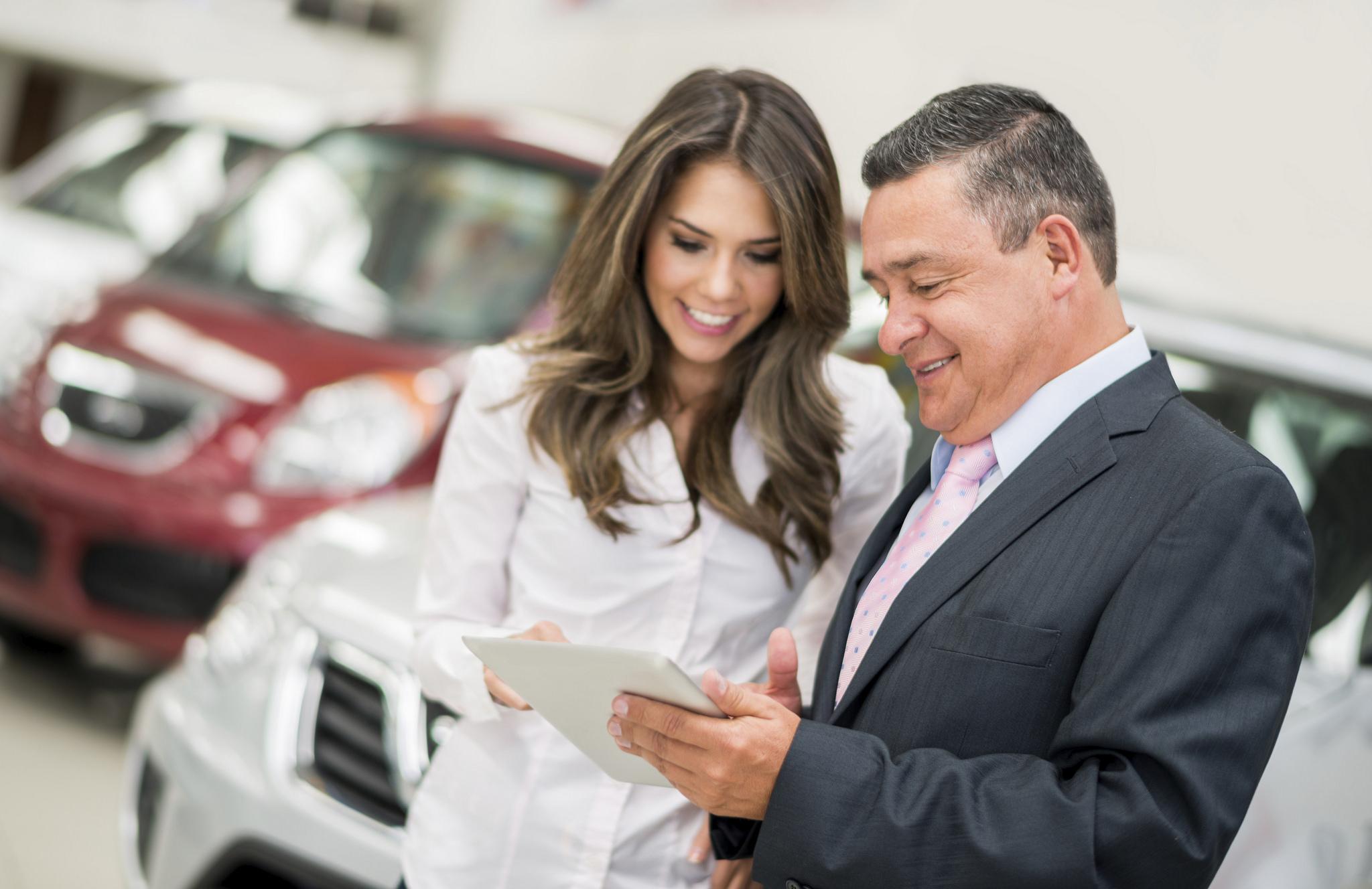 Man and Woman Car Dealership