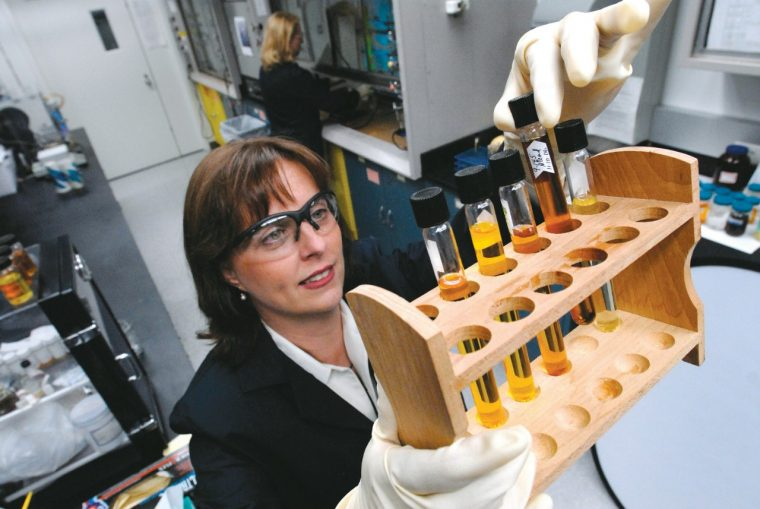 Ford Technical Leader of Plastics Research Debbie Mielewski observes a polyol separation in the laboratory