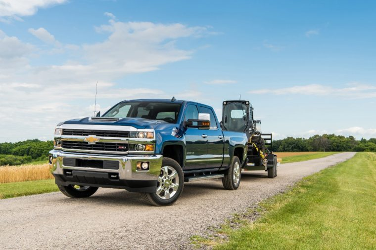 2018 Silverado 2500 HD Deep Ocean Blue Metallic LTZ Z71 Crew Cab towing John Deere Skid Steer with a Big Tex Trailer. Towing 10,808 pounds (total weight of trailer and equipment combined).