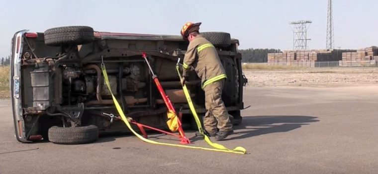 firefighters stabilize vehicle