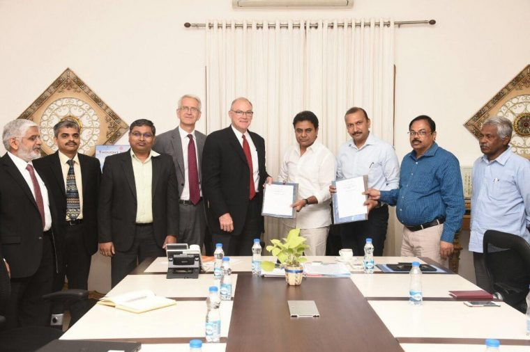Ford executives with Navin Mittal, Secretary MA&UD and T Chiranjeevulu Commissioner HMDA during the MoU signing