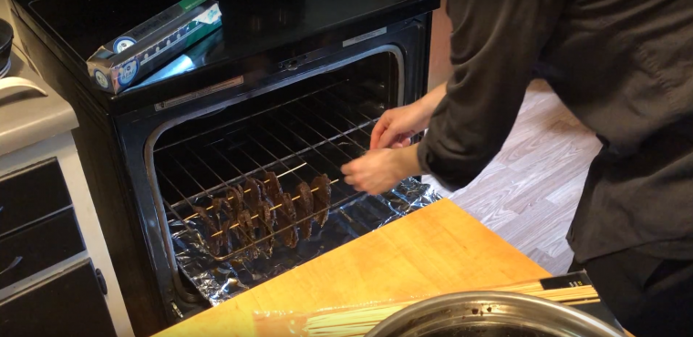 Putting the jerky meat in the oven