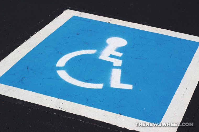 handicap parking space disability car vehicle law pavement