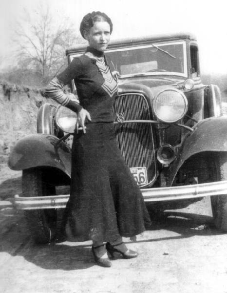 Bonnie Parker in front of a Ford V8