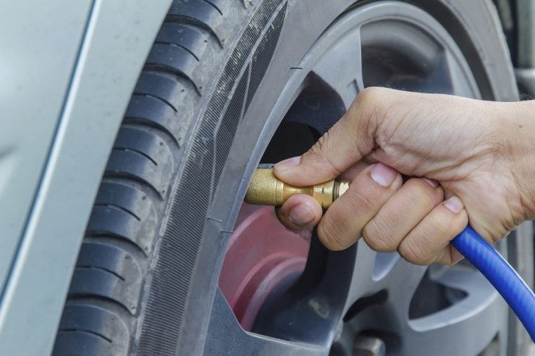 filling tires with air checking pressure