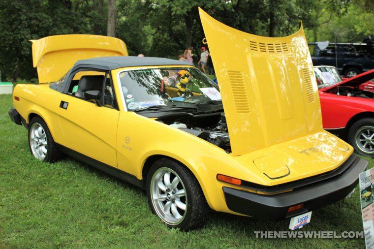 1980 Triumph TR8 yellow sports car hood pop British display