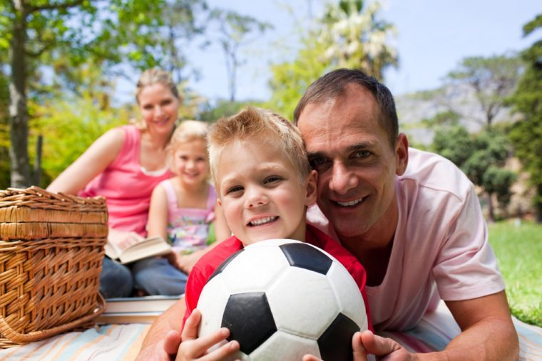 family at a picnic with soccer ball