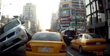 [Watch] Mitsubishi Crashes Into Cab, Sticks Landing, 8/10