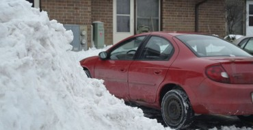 Woman Reports Car Stolen, Finds it Buried Under Snow