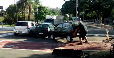 [VIDEO] Brazilian Hulk Lifts Car Out of Bike Lane, Bikes Away Calmly