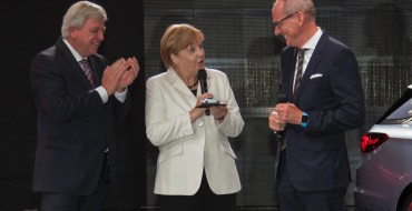 Opel Presents Angela Merkel with New Astra (Toy)