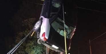 Woman Rescued After Car Gets Tangled in Power Lines, Insurance Agent Weeps Uncontrollably