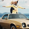 Rebel Wilson Pilots 1978 Camaro Z28 in New Booking.com Commercial