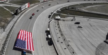 Watch a Chevy Silverado HD Pull a Giant American Flag Around a NASCAR Racetrack [VIDEO]