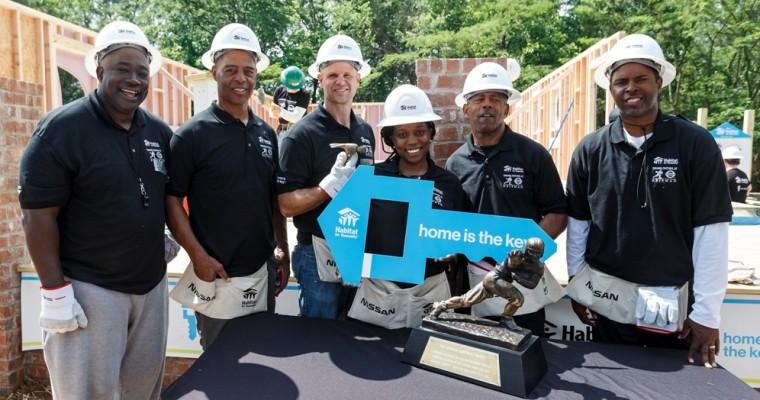 5 Heisman Winners Build Habitat Home