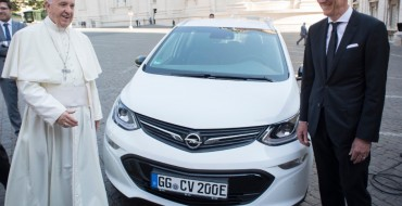 Opel CEO Presents Francis With Ampera-e Popelmobile