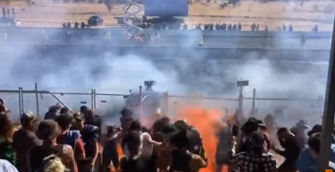 Burnout Gone Wrong: Vehicle Sprays Burning Fuel Onto Crowd [VIDEO]