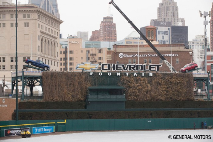 Detroit hoists up 2014 Chevy trucks in Comerica Park for Opening Day.