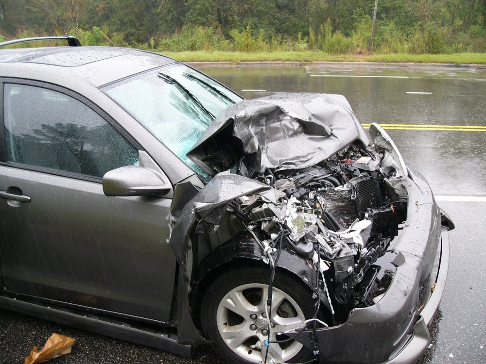 small car with crumpled front end due to a collision