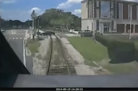Driver escapes train
