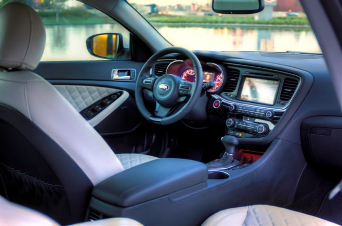 The interior of the 2015 Kia Optima. The 2016 Optima's cabin will inspire that of the future Kia hybrid crossover.
