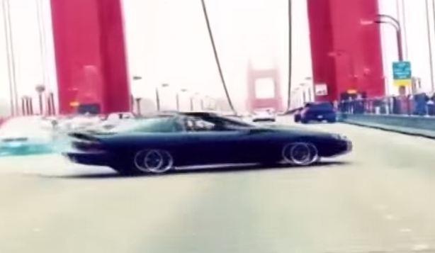 Camera catches Camaro doing doughnuts on the Golden Gate Bridge.