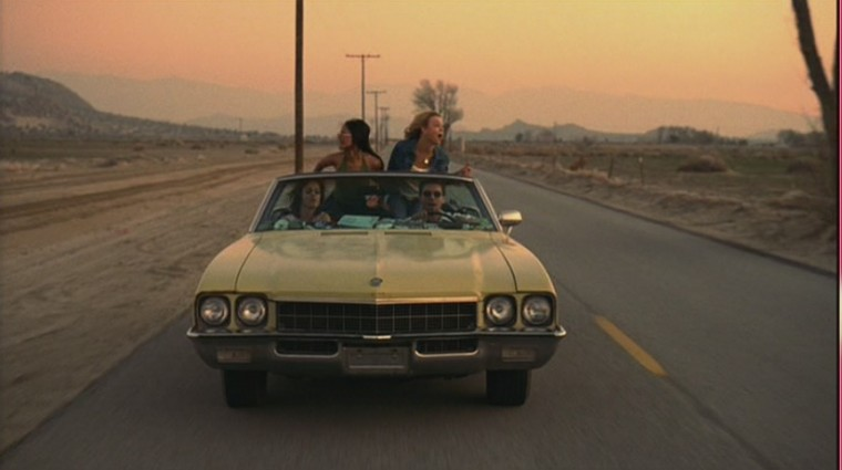 Crossroads review Yellow Car on road front 2