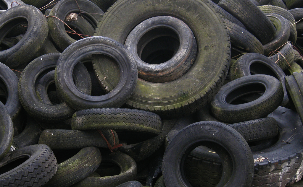 Stack Heap of Rubber old car tires. Make them recycled tires