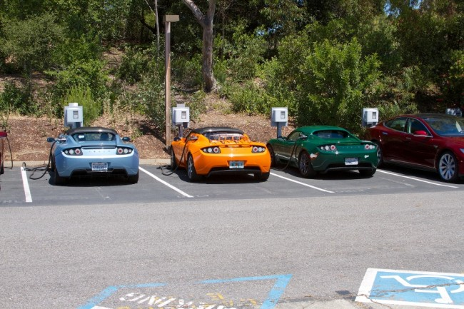 Electric Car Etiquette: Tesla electric cars in parking spot EV charging stations