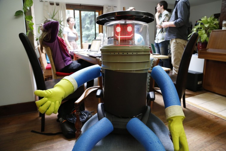 hitchiking robot hitchBOT at home with it's research team in Port Credit, Ontario.