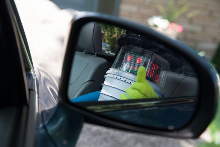 Hitchhiking Robot hitchBOT in side view mirror