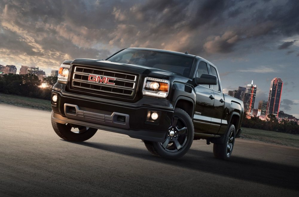 2015 GMC Sierra Elevation Edition with city skyline in background
