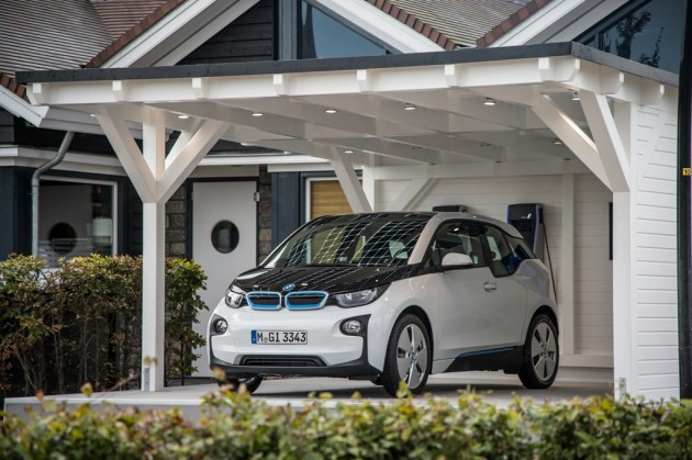 BMW i3 Most Expensive EVs In garage charging exterior