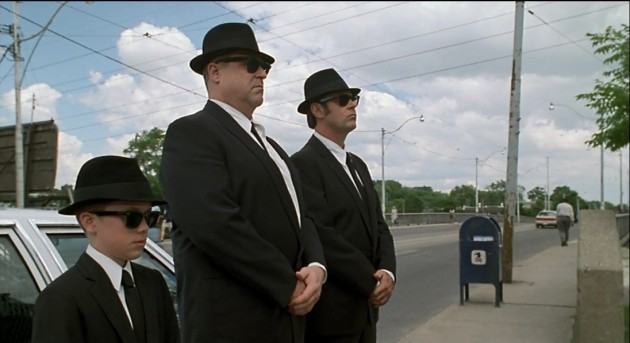 "Buster Blues (J. Evan Bonifant), ""Mighty"" Mac McTeer (John Goodman), and Elwood Blues: the new, un-improved Blues Brothers"