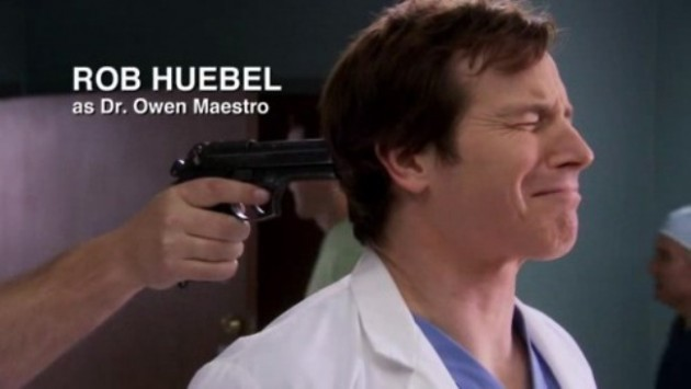 Rob Heubel with a gun to his head