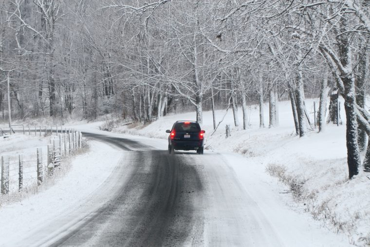Winter Driving myths snow cold icy road outdoors jeep trees