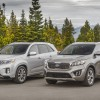 The all-new 2016 Kia Sorento (right) sits next to the outgoing 2015 model (left)