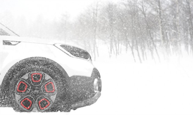 A teaser image of the electric  AWD Kia concept that will be unveiled at the 2015 Chicago Auto Show