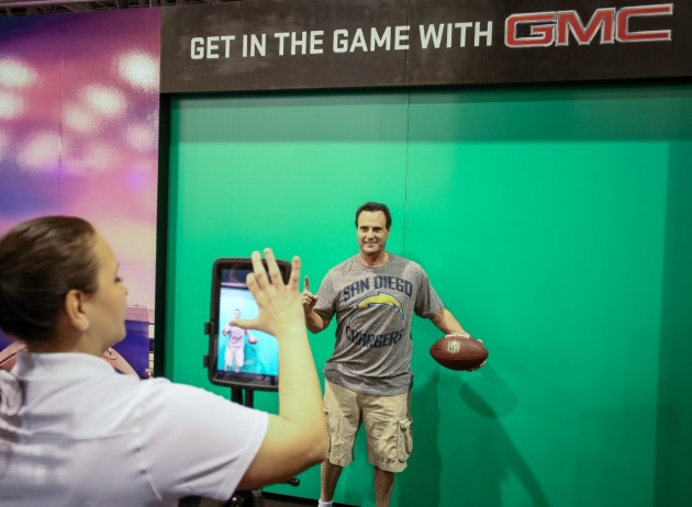 A fan poses for a mock Madden NFL 2015 video game cover