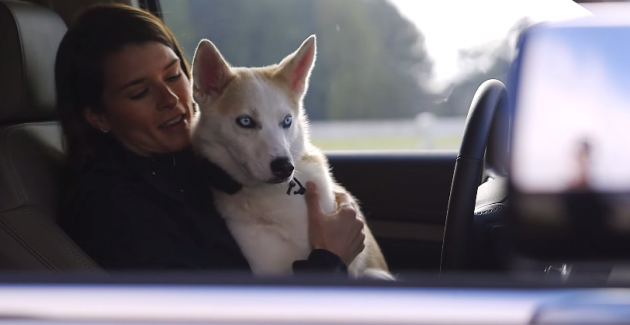 Danica Patrick and her dog ride in the 2015 Chevy Tahoe