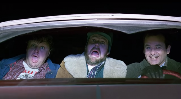 Bill Murray drives on railroad tracks in Groundhog Day
