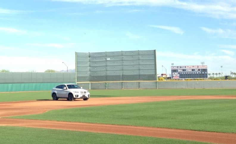 Jose Ramirez's car parked at the shortstop position at Goodyear Stadium
