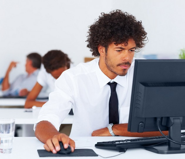 Man browsing internet website for used cars