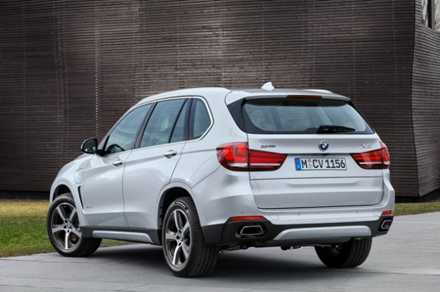 Silver plug-in BMW X5 xDrive40e SUV rear end