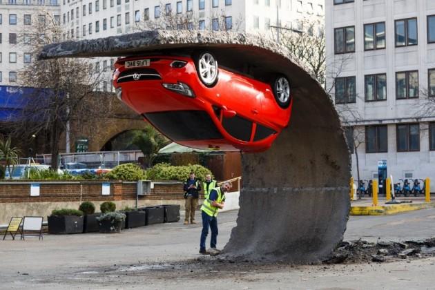Vauxhall Corsa art sculpture Alex Chinneck UK red pavement 2
