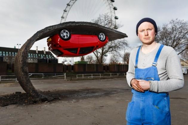 Vauxhall Corsa art sculpture Alex Chinneck UK red pavement