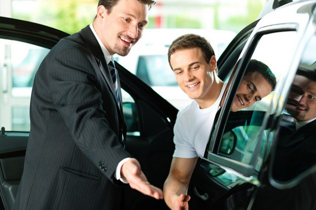 man at car dealership shopping browsing salesman lingo