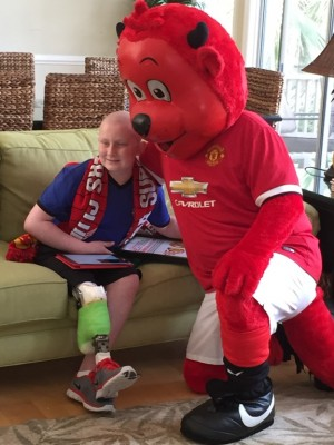 Matthew McMahon and Man U's Fred the Red share a moment during Chevy's #bestdayever