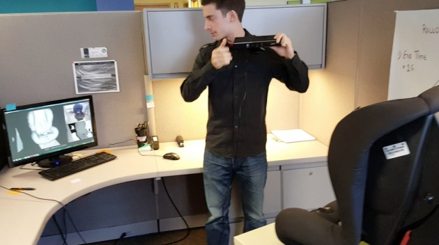 A GM engineer uses Kinect gaming technology to scan a car seat