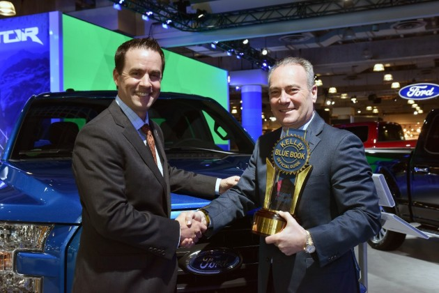 Stephen Odell, Ford executive vice president, global marketing and sales, receives the trophy for Best Overall Truck Brand in the 2015 Kelley Blue Book Brand Image Awards from Kelley Blue Book President Steve Lind